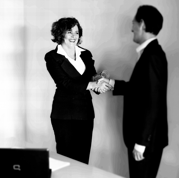 Angela shaking hands with colleague